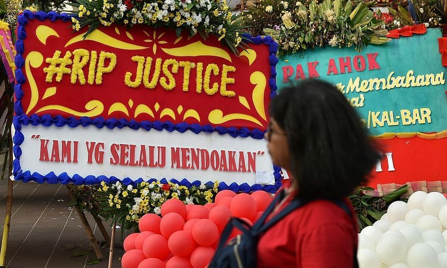 Farewell wreaths for Basuki Tjahaja Purnama, who was convicted of insulting Islam and given a two-year jail term, at Jakarta's City Hall on Wednesday.