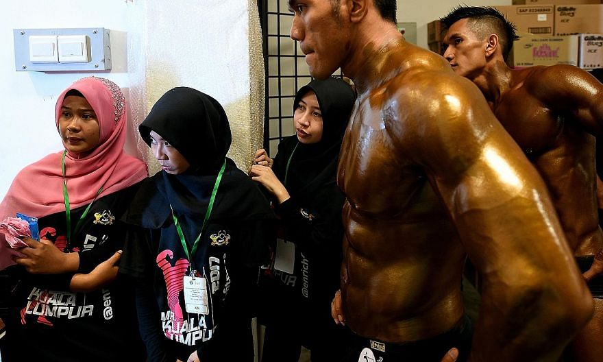 Contestants waiting backstage at the Mr Malaysia bodybuilding competition in Puchong, outside Kuala Lumpur, on Sunday. The majority of the 70 finalists were ethnic Malay Muslims. Malaysia is generally regarded as a moderate Muslim country, but fears
