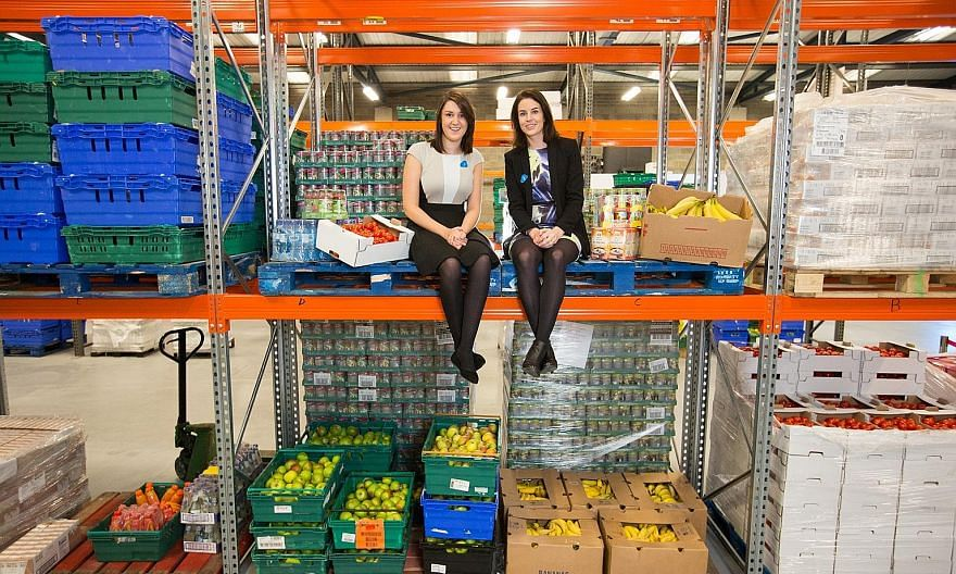 FoodCloud co-founders Iseult Ward (far left) and Aoibheann O'Brien at one of their warehouses.