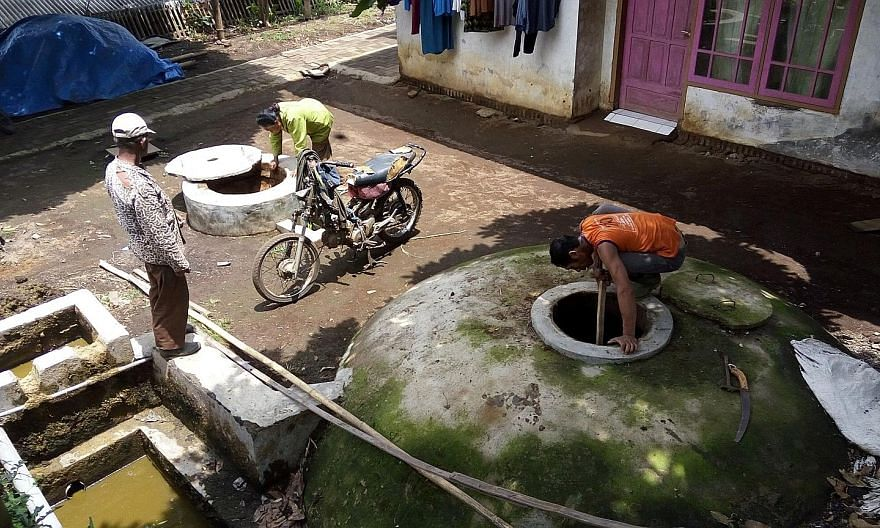 In Kalisari village, tofu makers pipe waste water into containers that generate biogas for homes.
