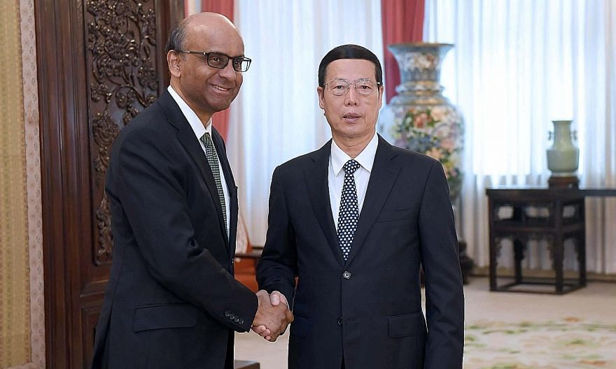 Deputy Prime Minister Tharman Shanmugaratnam meeting Chinese Vice-Premier Zhang Gaoli yesterday. During Mr Tharman's five-day trip to China, he met national and local leaders, including Premier Li Keqiang.