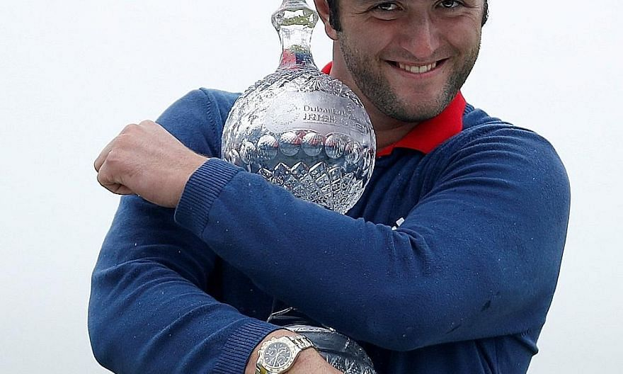Spanish golfer Jon Rahm with the Irish Open trophy after a final-round 65 at Portstewart in Northern Ireland. His 24-under total broke both the course and tournament record and he aims to emulate his legendary late countryman Seve Ballesteros by winn