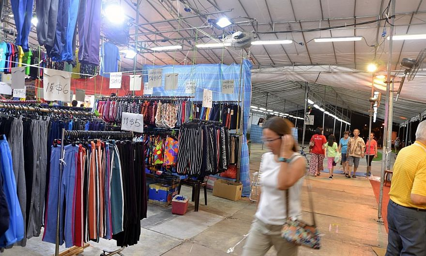 Sungei Road vendors unable to trade since the flea market closed a week ago have been asked to consider a temporary location at a pasar malam (above) beside Sembawang MRT station that opened on Sunday and will run for two weeks.