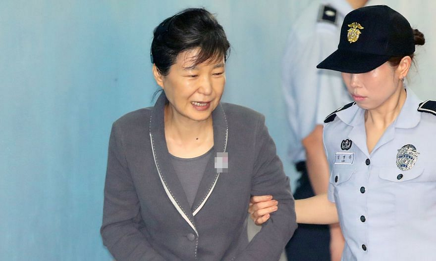 On Tuesday, prosecutors said ousted president Park Geun Hye (above) met Samsung heir Lee Jae Yong (right) secretly three times and discussed bribes in return for policy favours.