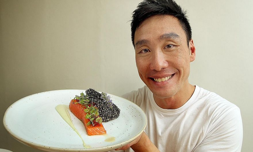 Mr Chia Wee Loon plated his spiced salmon trout confit dish with a squid-ink sago chip.