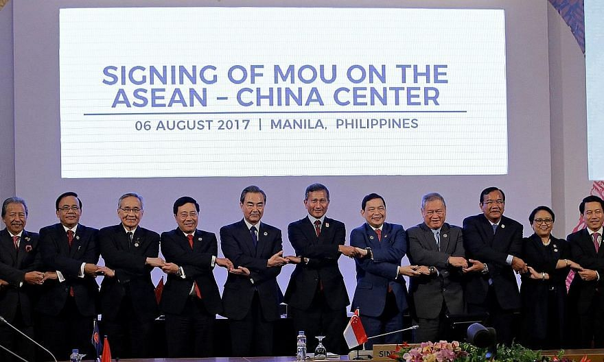 Chinese Foreign Minister Wang Yi (fifth from left) with his Asean counterparts at the signing of a memorandum of understanding on the Asean-China Centre in Manila yesterday. The others present were (from left) Malaysian Foreign Minister Anifah Aman,