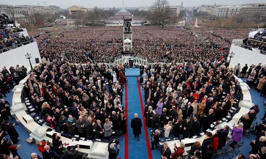 "Former White House press secretary Sean Spicer called the crowds watching Mr Donald Trump's presidential inauguration in January (above) the largest, ""period"", despite photographs showing otherwise."