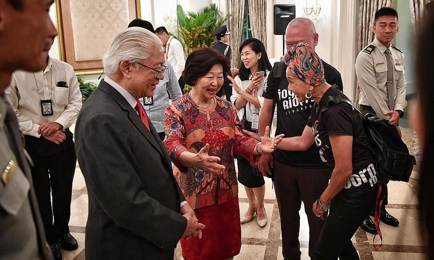 President Tony Tan Keng Yam and Mrs Mary Tan greeting Joyriders founder Joyce Leong at the Istana yesterday. The occasion was a tea reception hosted by the President to thank the organisers and participants of this year's National Day Parade. Recreat