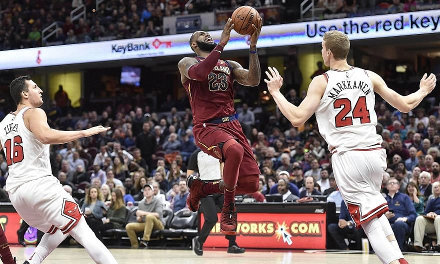 Cleveland forward LeBron James driving to the basket as Chicago forward Lauri Markkanen tries to blocks him. Moved from forward to point guard for the first time in five years, James scored 34 points and had 13 assists in the Cavs' 119-112 win.