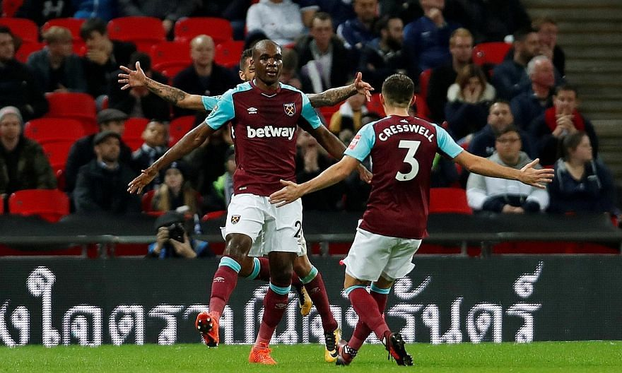 Angelo Ogbonna celebrating with Aaron Cresswell after putting West Ham 3-2 up against Tottenham. His goal turned out to be the winner in the League Cup fourth-round clash at Wembley, as the hosts lost concentration.