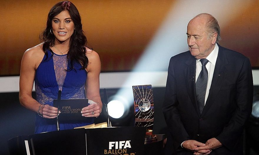 US national team goalkeeper Hope Solo and Mr Sepp Blatter at the 2013 Ballon d'Or ceremony in Zurich.