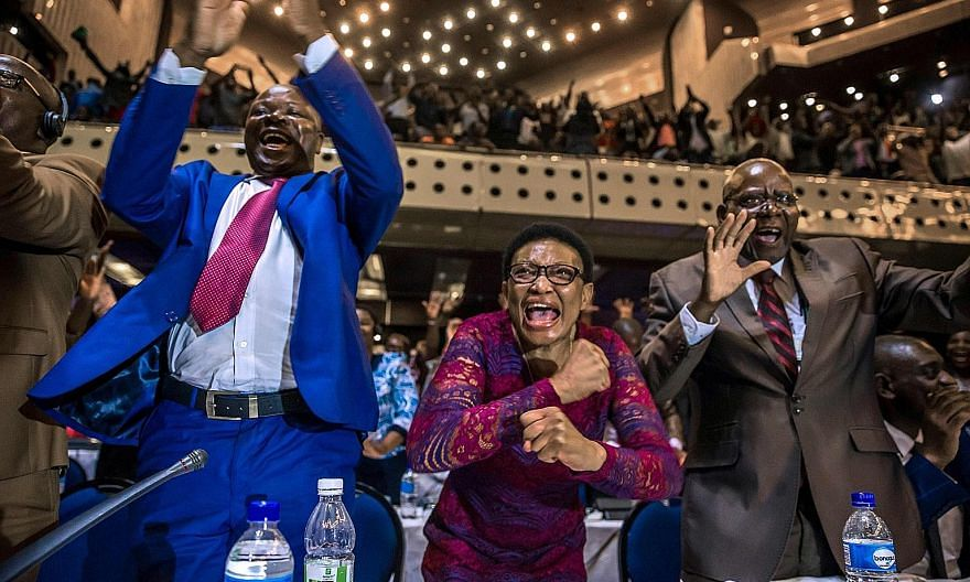 Zimbabwe's Members of Parliament celebrating after President Robert Mugabe announced his resignation on Tuesday in Harare. The announcement came after days of mounting pressure on the 93-year-old leader, whose long and authoritarian rule made him fea