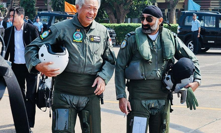 Defence Minister Ng Eng Hen and Air Vice-Marshal A.P. Singh on their way to board the Indian Air Force's Tejas Light Combat Aircraft during Dr Ng's visit to a joint training exercise at Kalaikunda Air Force Station in West Bengal yesterday.
