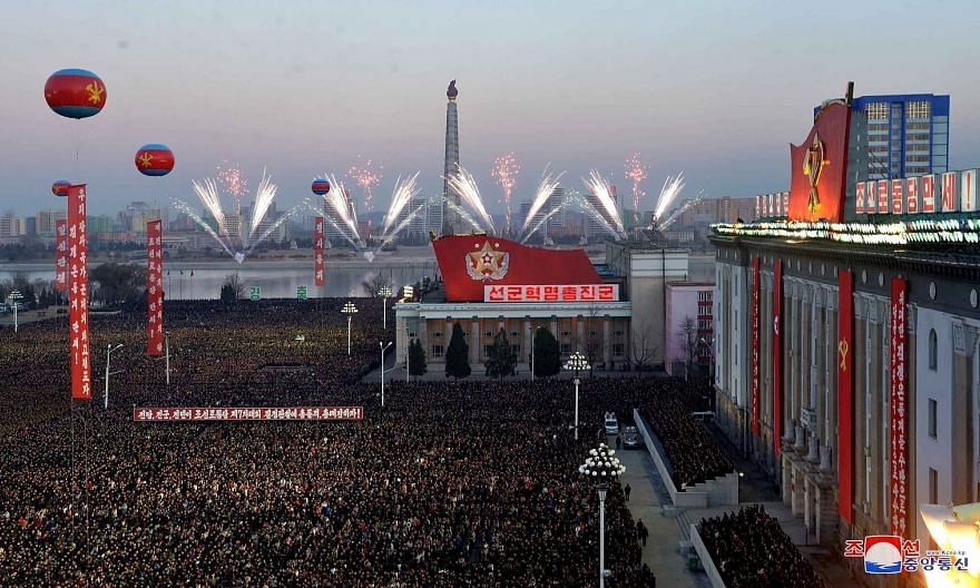 A photo from the Korean Central News Agency showing North Koreans celebrating the country's latest successful long-range missile test, last Wednesday, with fireworks and dancing in public squares.