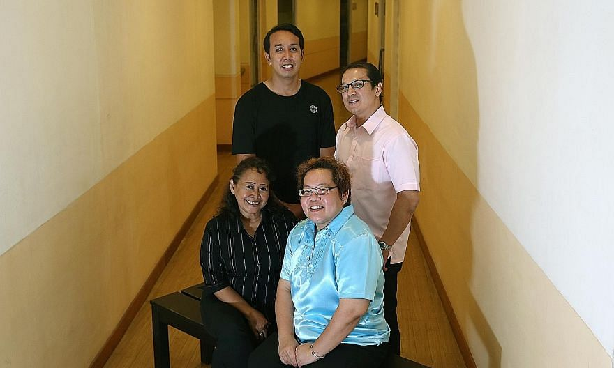 Acorn Quest managing director Janet Wee (seated right) with three who have received support from the group - (clockwise from seated left) Ms Kasmawati Kali Ubi, Mr Mohammad Asyraf Mustafa and Mr Stan Silvester.