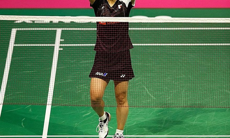 Japanese seventh seed Nozomi Okuhara saluting the crowd after winning her titanic battle against fourth seed P.V. Sindhu of India 21-19, 20-22, 22-20 at the BWF Badminton World Championships in Glasgow in August.