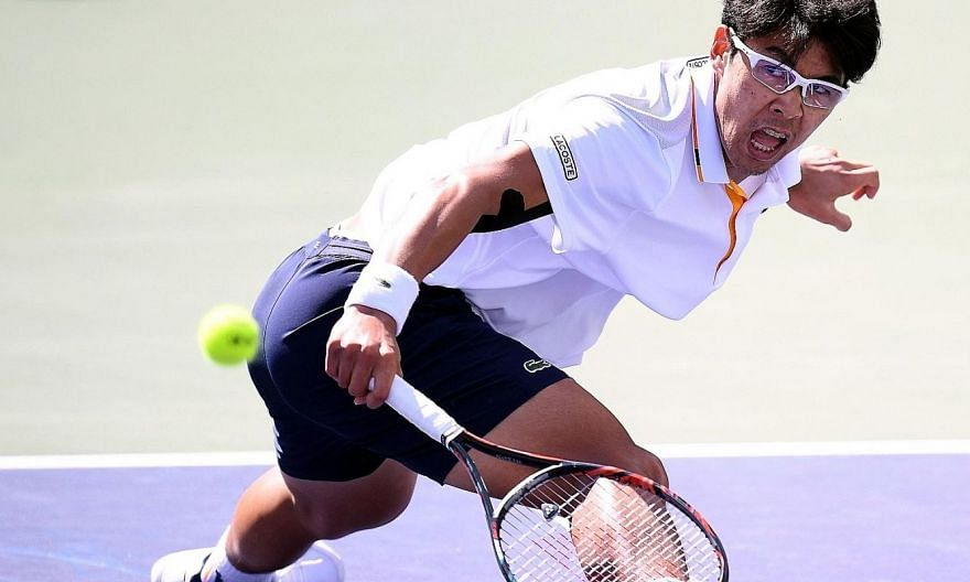 Chung Hyeon hitting a backhand against Pablo Cuevas during their Indian Wells last-16 match. Chung won in straight sets to take his win-loss record for the year to 15-5.