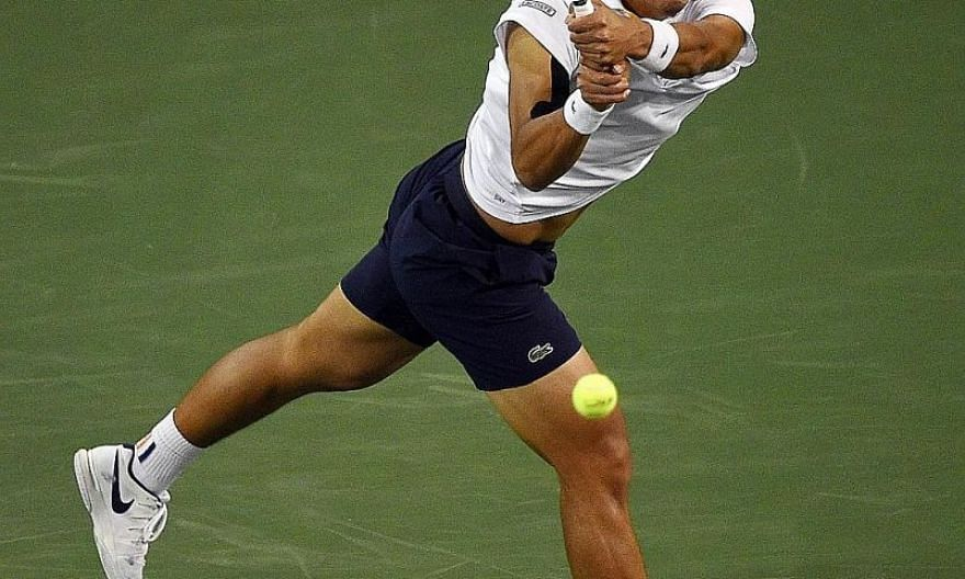 South Korea's Chung Hyeon hitting a running backhand against Roger Federer on Thursday. The Swiss world No. 1 won 7-5, 6-1 to move into the semi-finals at Indian Wells with a 16-0 unbeaten streak this year.