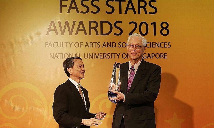 Emeritus Senior Minister Goh Chok Tong with NUS chairman Hsieh Fu Hua at the award ceremony at the One Farrer Hotel and Spa last night. Mr Goh received the Distinguished Arts and Social Sciences Alumni Award (Lifetime Achievement) at the event.