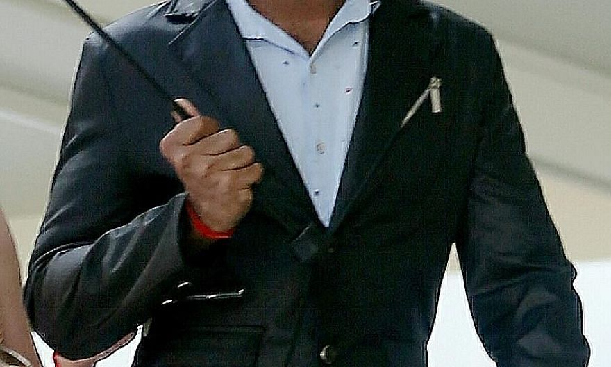 S. Chandran is accused of aiding claimants to fraudulently get money from a government scheme.
