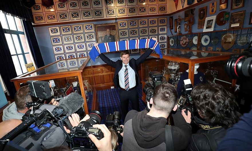 New Rangers manager Steven Gerrard holding a club scarf in the trophy room after a press conference at Ibrox yesterday.