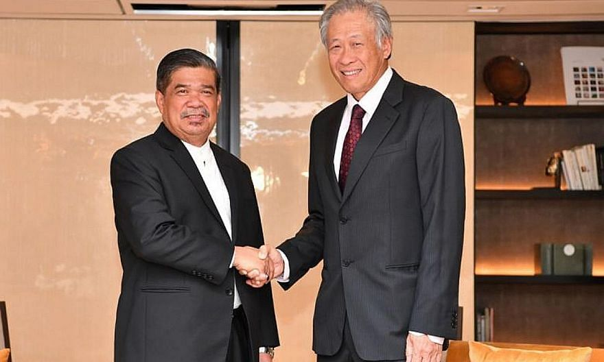 Defence Minister Ng Eng Hen and his Malaysian counterpart Mohamad Sabu at their first official meeting, which took place yesterday on the sidelines of the Shangri-La Dialogue.
