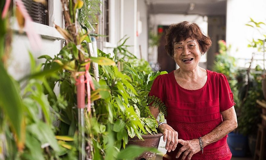Madam Kok Yoon Hin, 86, outside her HDB flat. The octogenarian is today the oldest volunteer at the Touch Senior Activity Centre in Geylang Bahru.