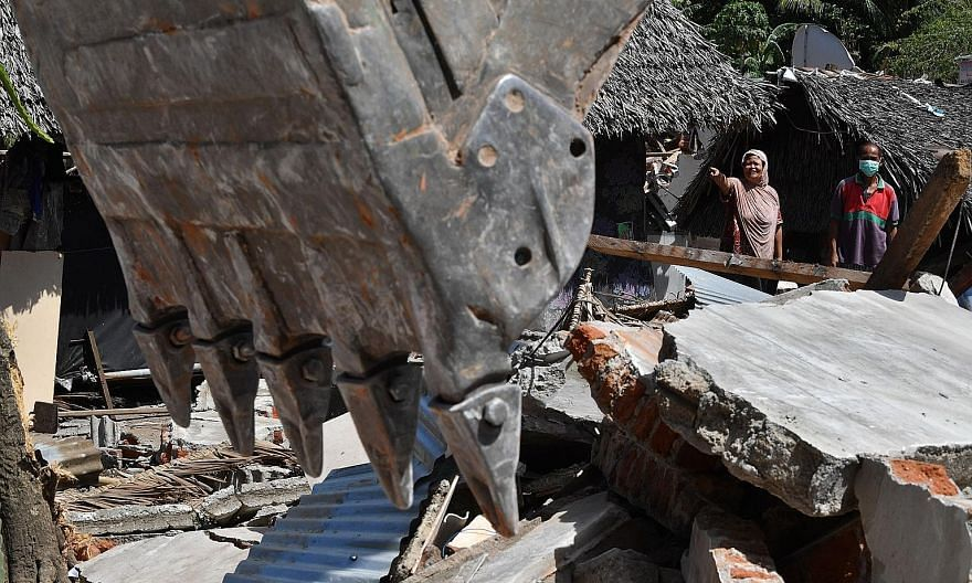 A house in the Gangga area being destroyed yesterday for security reasons, after two deadly tremors hit the Indonesian island of Lombok in recent weeks, killing nearly 400 people. The earthquakes struck during the crucial tourism season, when hotels,