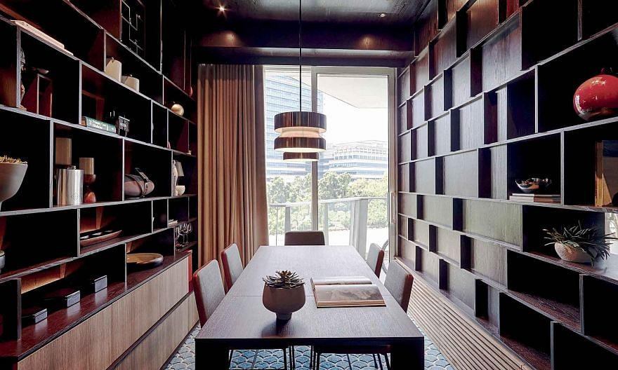 Full-height shelves (left) not only act as dividers for the living room, dining room and bedrooms, but also offer plenty of storage. (From left) The ceiling of the dining room has a dark veneer for a cocooned environment; the home owners' eclectic co