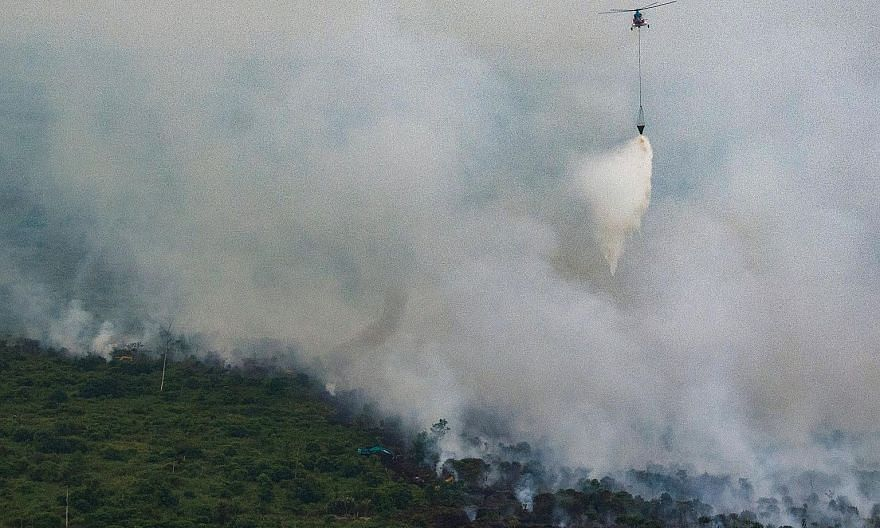 An Indonesian helicopter dumping water over a forest fire in Sumatra last month. A severe El Nino in 2015 exacerbated the forest fires in Indonesia, with hotter and drier weather intensifying the blazes and resulting in an intense haze that shrouded