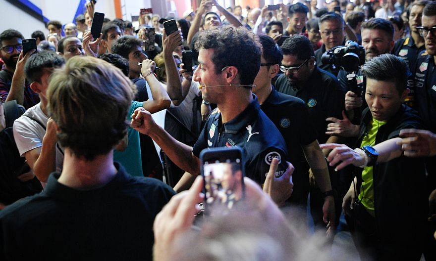 Australian F1 driver Daniel Ricciardo meeting fans at Ion Orchard's outdoor atrium on Wednesday.