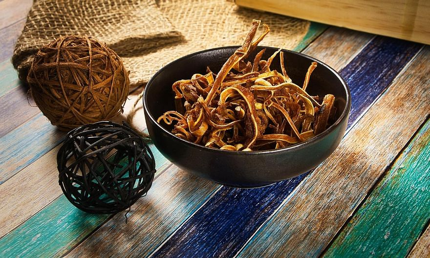 Crispy Pig's Ear is deep-fried to a crisp and the curry powder it is coated with is perfect - not overly spicy or salty.
