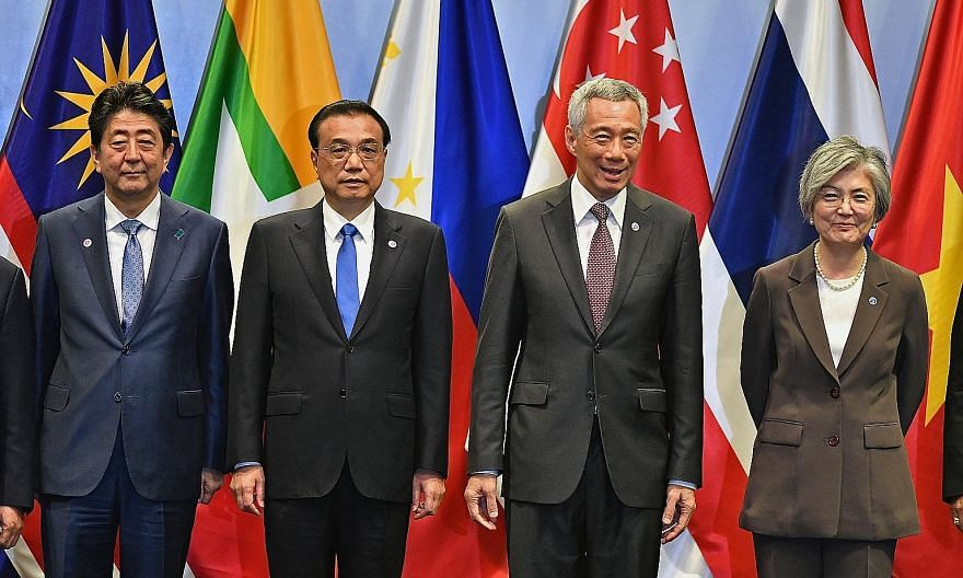 Prime Minister Lee Hsien Loong with (from far left) Japanese Prime Minister Shinzo Abe, Chinese Premier Li Keqiang and South Korean Foreign Minister Kang Kyung-wha at the Asean Plus Three Summit yesterday. The leaders agreed to speed up regional acti