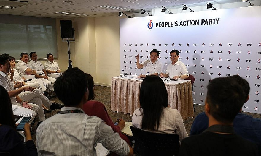 People's Action Party first assistant secretary-general Heng Swee Keat (right) and second assistant secretary-general Chan Chun Sing at the party's media conference on Friday to announce the new line-up of the party's Central Executive Committee.