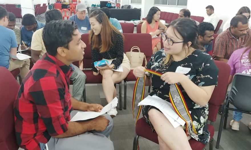 Participants at a Lingua Singapura session where they are paired up to learn their partner's native language.