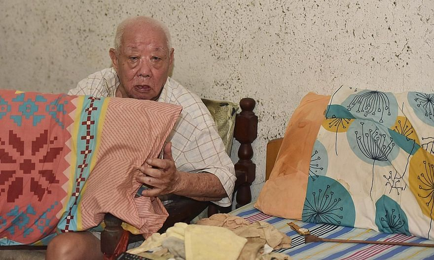Mr Tan Lye Heng hopes to get a new pillow to replace his two old pillows.