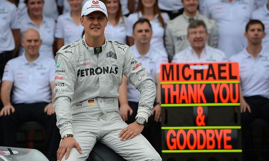 Seven-time Formula One world champion Michael Schumacher poses with the Mercedes team in the pits of the Interlagos racetrack in Brazil to commemorate his last race in 2012.