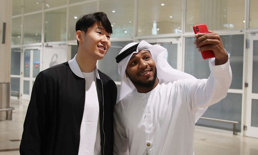 Time for a wefie as South Korea's Son Heung-min arrives at Dubai airport yesterday to join his national team in the Asian Cup.