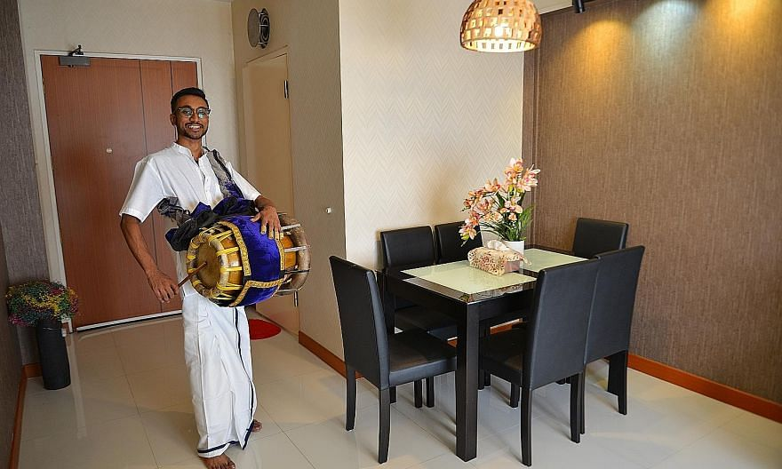 Mr Jathishweran Naidu dressed in traditional Indian garments and carrying his thavil. The 24-year-old will play the instrument for eight to 10 hours during the Thaipusam procession from 3am today with his group, Hanusakthi Hanuman Dass.