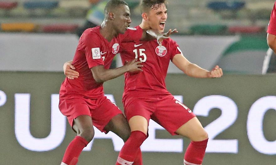Qatar's Almoez Ali (left) celebrating with Bassam Al-Rawi after scoring his second goal in the 2-0 group-stage win over Saudi Arabia at the Zayed Sports City Stadium in Abu Dhabi on Jan 18. The United Arab Emirates has formally questioned the eligibi