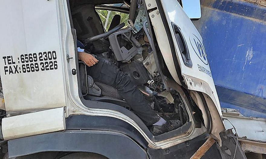 The driver was trapped in his seat after his truck rammed into one that was stationary. He was subsequently rescued with the use of hydraulic tools and taken to hospital.