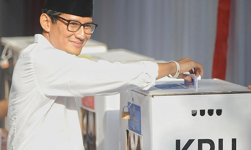 Vice-presidential candidate Sandiaga Uno casting his vote at a polling station in South Jakarta last week.