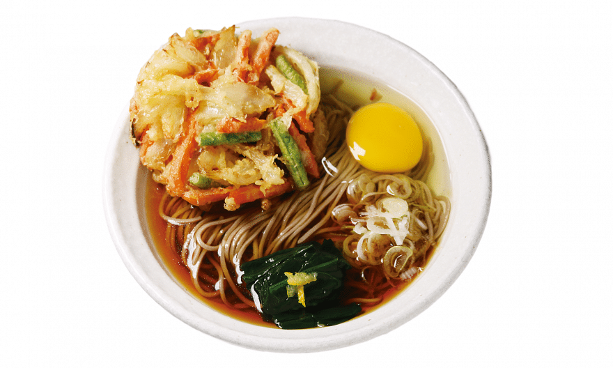 Tokyo Soba's Ten Tama Soba is a delicious bowl of freshly made buckwheat noodles in a moreish broth, paired with skillfully fried mixed vegetable tempura and topped with an egg.