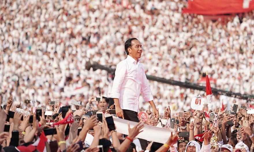 Indonesia's President Joko Widodo, being cheered on by supporters during a campaign rally in Jakarta last month. It looks increasingly likely the General Elections Commission, which oversaw the presidential election on April 17, will declare him the
