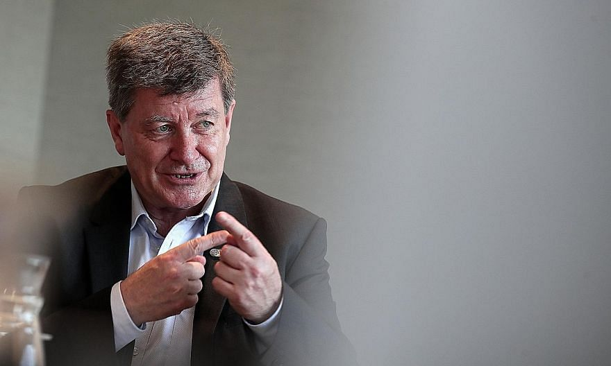 International Labour Organisation director-general Guy Ryder is less concerned about jobs being lost to technology than the challenges in preparing workers so they can function in the new economy. ST PHOTO: KELVIN CHNG