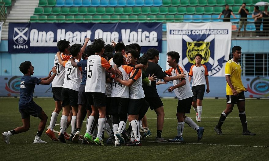 SAJC players rejoicing after beating VJC 4-1 for their school's first football title at the Jalan Besar Stadium yesterday. They had also beaten the defending champions 1-0 in a quarter-final round-robin match. ST PHOTO: JASON QUAH