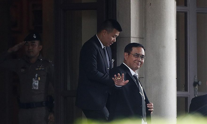 Thai Prime Minister Prayut Chan-o-cha leaving Government House in Bangkok yesterday. The former army chief was nominated for the premiership by Palang Pracharath Party, which spent weeks cobbling together a 19-party coalition with a slim Lower House