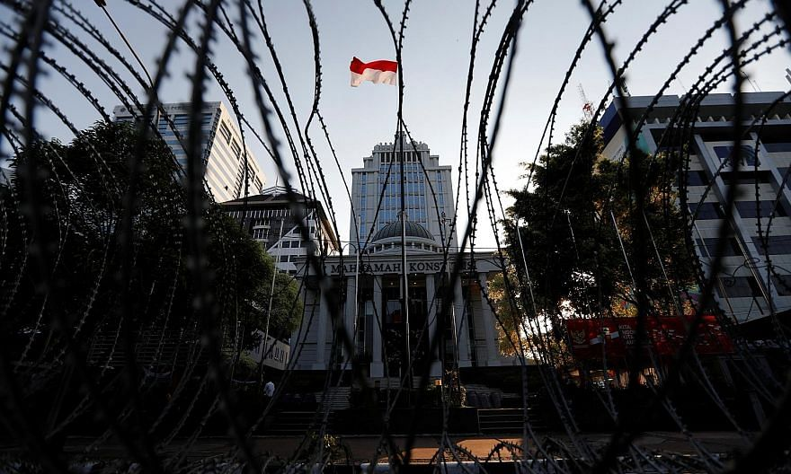 Barbed wires outside Indonesia's Constitutional Court in Jakarta. The court's panel of nine judges is expected to rule on Friday in Mr Prabowo Subianto's suit claiming that the April 17 presidential election was rigged.