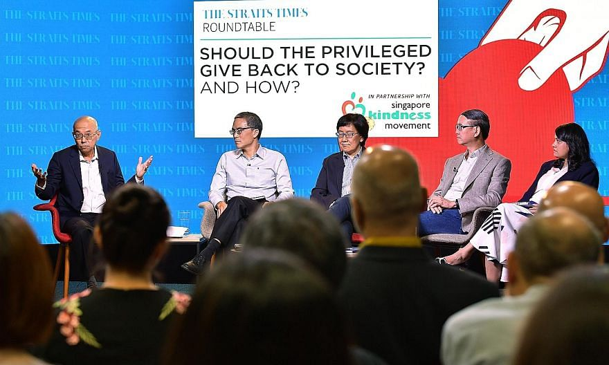 Yesterday's panel discussion on the topic of privilege in Singapore and giving back to society was moderated by (from left) Straits Times editor-at-large Han Fook Kwang, and involved Lien Foundation chairman Laurence Lien; Singapore Management Univer