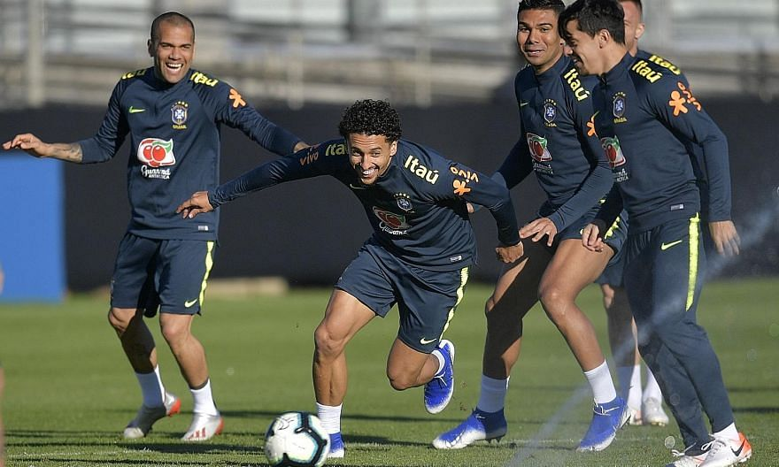 Above: Peru's Paolo Guerrero during training on Friday for today's final. Left: Brazil's players (from left) Dani Alves, Marquinhos and Casemiro having fun during training last month.